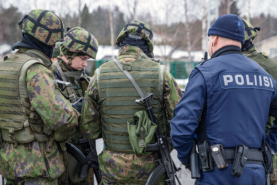 Finnish soldiers and a police officer