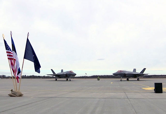 Airplanes and flags on the runway