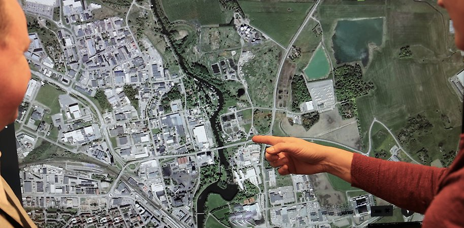persons pointing at map